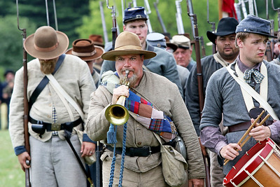 Candace H. Johnson Greg Bochniak, of Pell Lake, Wis. plays his bugle after the Battle of Big Bethel during Civil War Days at the Lakewood Forest Preserve in Wauconda.