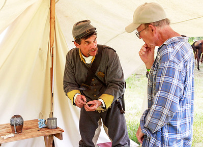 Candace H. Johnson Dan Chroninger, of Readstown, Wis. with the 9th Virginia Calvary Company B talks with Robert Olson, of Waukegan about fuses for the cannons during Civil War Days at the Lakewood Forest Preserve in Wauconda.