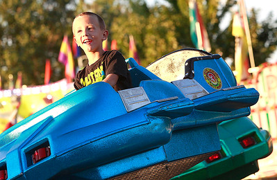 Candace H. Johnson Austin Fiduccia, 5, of Antioch rides the Mini-Jets during the Antioch Taste of Summer in downtown Antioch.