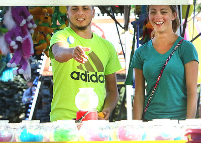 Candace H. Johnson A.J. Marsiglio and Jamie Huber, both 19, of Antioch play the Goldfish game during the Antioch Taste of Summer in downtown Antioch.