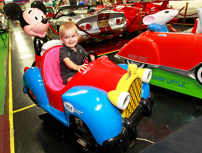 Candace H. Johnson Brock Konecny, 1, of Lake County sits in a Mickey Mouse car at the Volo Auto Museum in Volo. Brock was at the museum with his parents, Kathy and David, and brother, David, 3.