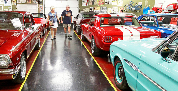 Candace H. Johnson Pat and Jim Johnson, of Wheeling walk down the aisle looking at cars at the Volo Auto Museum in Volo.