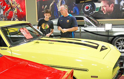 Candace H. Johnson Luc Larson, 12, of Bensonville and his father, Greg, look at cars at the Volo Auto Museum in Volo.