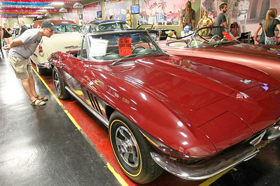 Candace H. Johnson John Zrnich, of Inverness looks at a 1966 Chevrolet Corvette for sale at the Volo Auto Museum in Volo.
