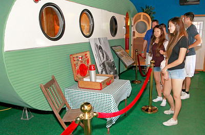 Candace H. Johnson Sunny and Rob Burke, of Schaumberg and their kids, Paige, 14, and Alex, 17, look at a 1940's Airfloat trailer at the Volo Auto Museum in Volo.