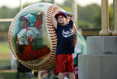 Ty Maurer, 8 with the Crystal Lake Bulldogs, waits for opening ceremonies to start for the MCYSA 15-U baseball tournament at Lippold Park on Friday, July 22, 2016 in Crystal Lake. John Konstantaras photo for the Northwest Herald