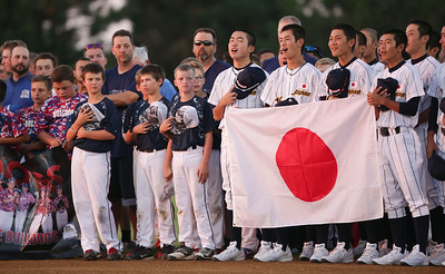 Japanese players sing their national anthem during the opening ceremonies for MCYSA 15-U baseball tournament at Lippold Park on Friday, July 22, 2016 in Crystal Lake. John Konstantaras photo for the Northwest Herald