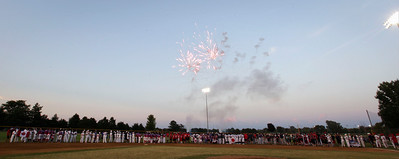 Players and coaches watch fireworks during opening ceremonies for MCYSA 15-U baseball tournament at Lippold Park on Friday, July 22, 2016 in Crystal Lake. John Konstantaras photo for the Northwest Herald