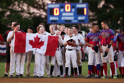 Canadian players sing their national anthem during the opening ceremonies for MCYSA 15-U baseball tournament at Lippold Park on Friday, July 22, 2016 in Crystal Lake. John Konstantaras photo for the Northwest Herald