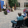 A scene during Midsummer Night's Dream in the outdoor courtyard of the Batavia Fine Arts Centre on July 22.
