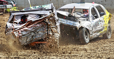 Candace H. Johnson Ryan Dillow's, of Beach Park (4WD) car gets crushed by Andy Die (#71) in the Bring What You Brung class in the Crash Fest Demolition Derby during the Lake County Fair at the Lake County Fairgrounds in Grayslake.