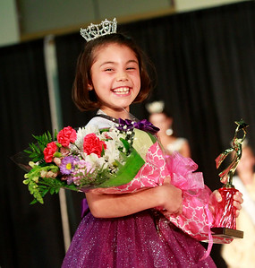 Candace H. Johnson Darby Leetch, 8, of Round Lake takes a walk on stage after being crowned Little Miss Lake County Fair Queen 2016 in the Pageant during the Lake County Fair at the Lake County Fairgrounds in Grayslake.