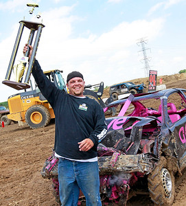Candace H. Johnson Keith Whittington, of Ingleside is all smiles having won 1st place in the Compact Class with his Pontiac Grand Am in the Crash Fest Demolition Derby during the Lake County Fair at the Lake County Fairgrounds in Grayslake.