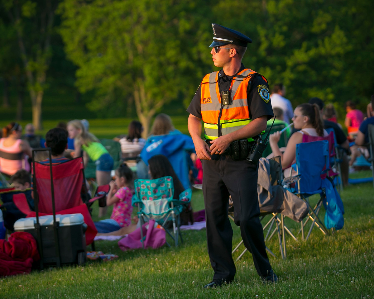 Daryl Quitalig - For Shaw Media Woodstock Police Officer Chris Naatz patrols Emricson Park before the Woodstock fireworks show Tuesday, July 4, 2017.