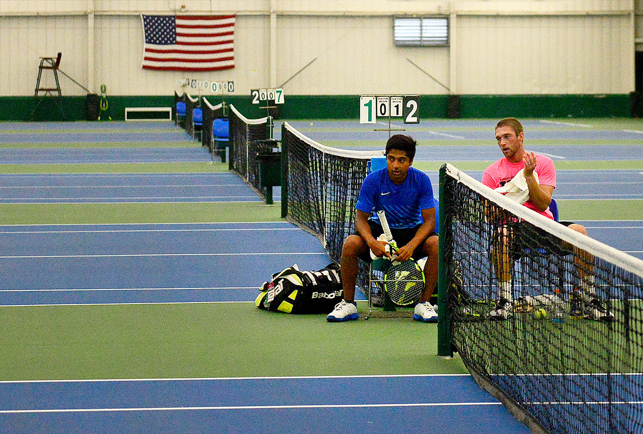 Kayla Wolf - for Shaw Media  Kailash Panchapakesan, left, and Sam Sweeney take a break between sets during the men's open singles championship match Sunday, July 9, 2017, during the McHenry County Tennis Classic on at The Racket Club in Algonquin. Panchapakesan won the game two sets to one.
