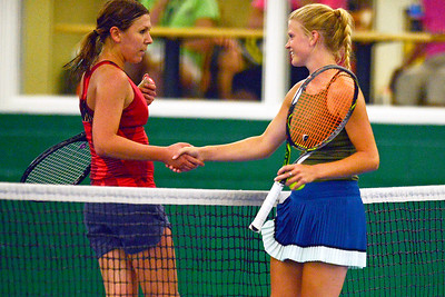 Kayla Wolf - for Shaw Media  Kelly Johnson, left, shakes hands with Hannah Hougland following their women's open championship match Sunday, July 9, 2017 at the McHenry County Tennis Classic at The Racket Club in Algonquin. Johnson won the competition.