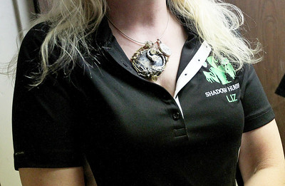 Candace H. Johnson-For Shaw Media Shadow Hunters Liz Nygard, a paranormal investigator, wears pietersite from Cuba to protect her while on location looking for spirits at The Lodge of Antioch, a Northwoods Pub & Eatery, on Main Street.