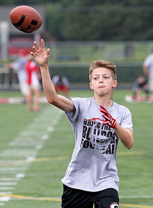 Candace H. Johnson-For Shaw Media Grant Pederson, 14, of Lake Villa plays quarterback as he throws the ball during a receiver drill at the Grant Bulldogs Youth Football Clinic at Grant Community High School.