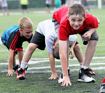 Candace H. Johnson-For Shaw Media Drake Madsen, 8, of Ingleside practices stances during the Grant Bulldogs Youth Football Clinic at Grant Community High School.