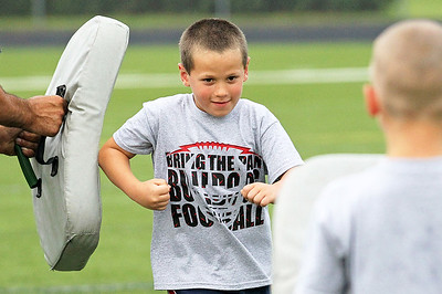 Candace H. Johnson-For Shaw Media Jonathan Mason, 7, of Fox Lake works on blocking during the Grant Bulldogs Youth Football Clinic at Grant Community High School.
