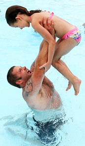 Candace H. Johnson-For Shaw Media Joe Patterson, of Ingleside has fun lifting up his daughter, Dylylah, 8, in the pool during $2 Tuesdays at the Round Lake Area Park District Aquatics Center on Hart Road in Round Lake.