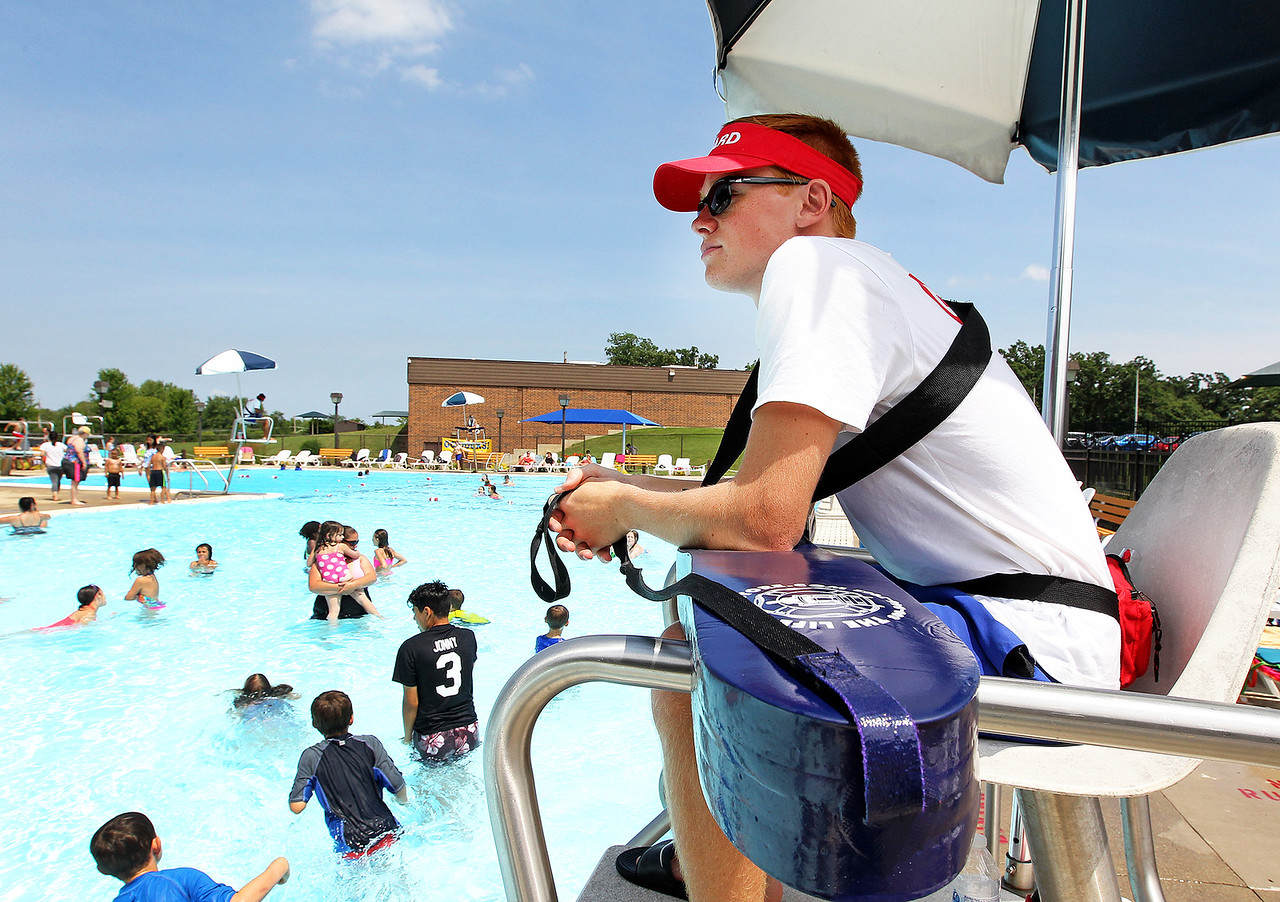 Candace H. Johnson-For Shaw Media Lifeguard Jack Onarheim, 19, of Round Lake Beach watches over swimmers in the pool during $2 Tuesdays at the Round Lake Area Park District Aquatics Center on Hart Road in Round Lake.