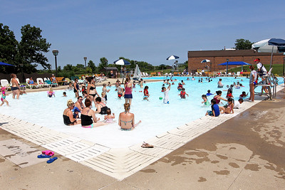 Candace H. Johnson-For Shaw Media Adults and kids swim during $2 Tuesdays at the Round Lake Area Park District Aquatics Center on Hart Road in Round Lake.The pool is a 0 depth pool to 12 feet.