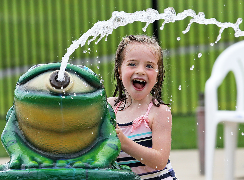 Candace H. Johnson-For Shaw Media Geneva Erl, 4, of Round Lake has fun shooting water in the Splash Pad during $2 Tuesdays at the Round Lake Area Park District Aquatics Center on Hart Road in Round Lake.
