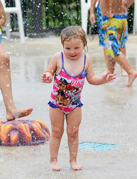 Candace H. Johnson-For Shaw Media Melanie Glassman, 3, of Round Lake has fun in the Splash Pad during $2 Tuesdays at the Round Lake Area Park District Aquatics Center on Hart Road in Round Lake.