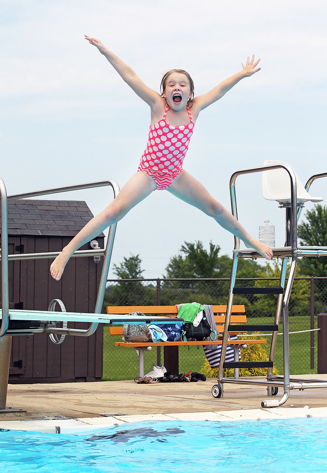 Candace H. Johnson-For Shaw Media Kaitlyn Bartlett, 9, of Ingleside has fun jumping off the diving board during $2 Tuesdays at the Round Lake Area Park District Aquatics Center on Hart Road in Round Lake.