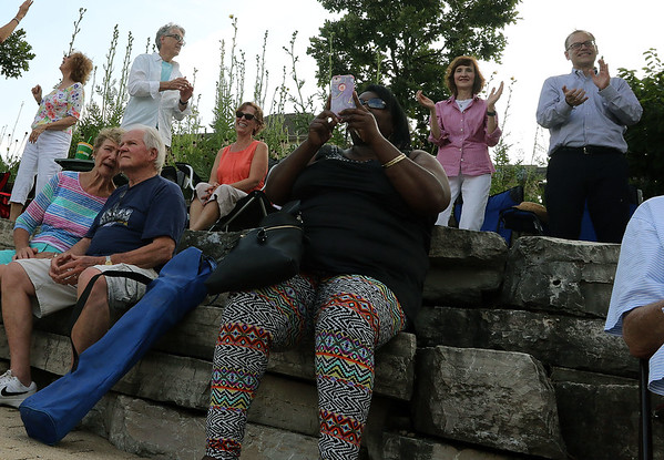 The crowd watches The Victory Travelers perform during a summer concert at RiverPark in Geneva on July 9.