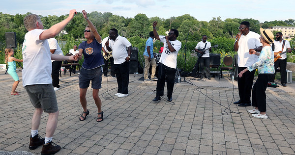 The crowd dances along as The Victory Travelers perform during a summer concert at RiverPark in Geneva July 9.