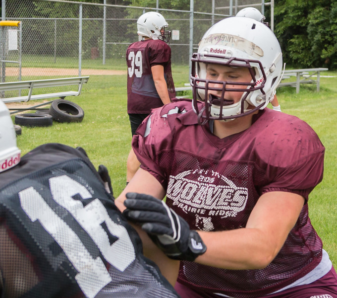 Ken Koontz - For Shaw Media Prairie Ridge senior lineman Justin Grapenthin works on technique during a practice drill Friday July 14, 2017 in Prairie Grove. The Wolves are defending Class 6A State Champions.