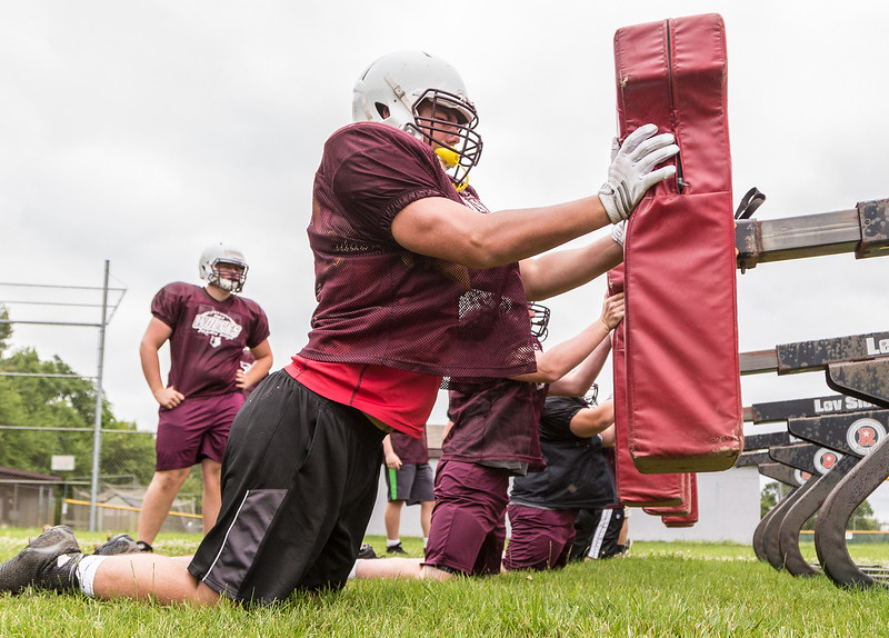 Ken Koontz - For Shaw Media Prairie Ridge senior lineman Jeff Jenkins hits the sled during a practice drill Friday July 14, 2017 in Prairie Grove. The Wolves are defending Class 6A State Champions.