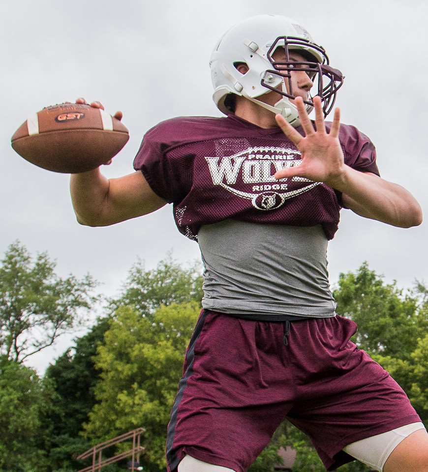 Ken Koontz - For Shaw Media Prairie Ridge senior quarterback Samson Evans warms up during practice Friday July 14, 2017 in Prairie Grove. The Wolves are defending Class 6A State Champions.