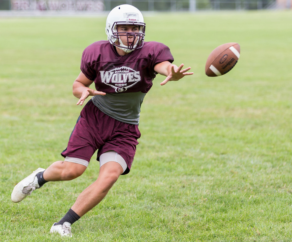 Ken Koontz - For Shaw Media Prairie Ridge senior quarterback Samson Evans pitches the ball during a practice drill Friday July 14, 2017 in Prairie Grove. The Wolves are defending Class 6A State Champions.