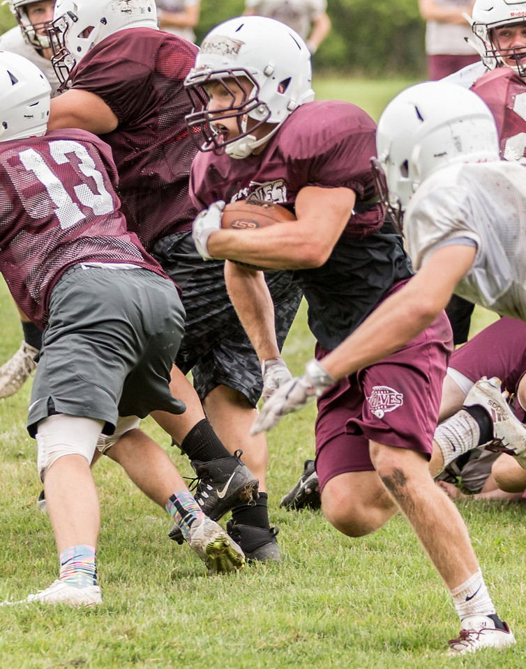 Ken Koontz - For Shaw Media Prairie Ridge senior running back Zach Gulbransen finds an opening through the defense during a practice drill Friday July 14, 2017 in Prairie Grove. The Wolves are defending Class 6A State Champions.