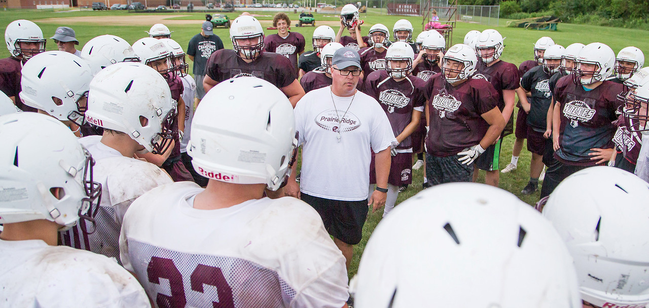 Ken Koontz - For Shaw Media Prairie Ridge head coach Chris Schremp addresses his team during practice Friday July 14, 2017 in Prairie Grove. The Wolves are defending Class 6A State Champions.