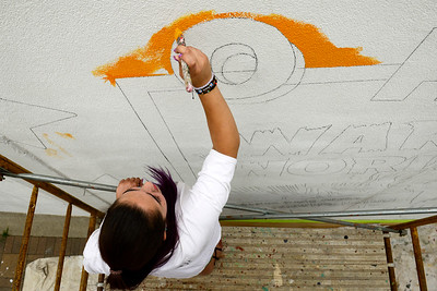 Kayla Wolf - for Shaw Media Nadia Adamany works on a portion of the mural Friday, July 14, 2017. This is the first mural Nadia has worked on with her father.