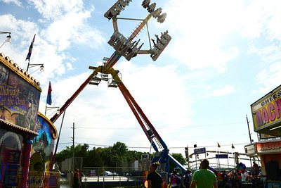 Kayla Wolf - for Shaw Media Onlookers watch riders swing through the air Saturday, July 15, 2017 at Fiesta Days in McHenry. Fiesta Days is an annual event that features a carnival, live music, car show, arts and crafts, children's events, food and fireworks.
