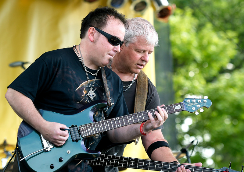 Kayla Wolf - for Shaw Media Guitarists Doug Ehrhardt, left, and Scott Thompson of Eff'm Radio play at Fiesta Days on Saturday, July 15, 2017 at Petersen Park in McHenry. It was Eff'm Radio's debut performance.