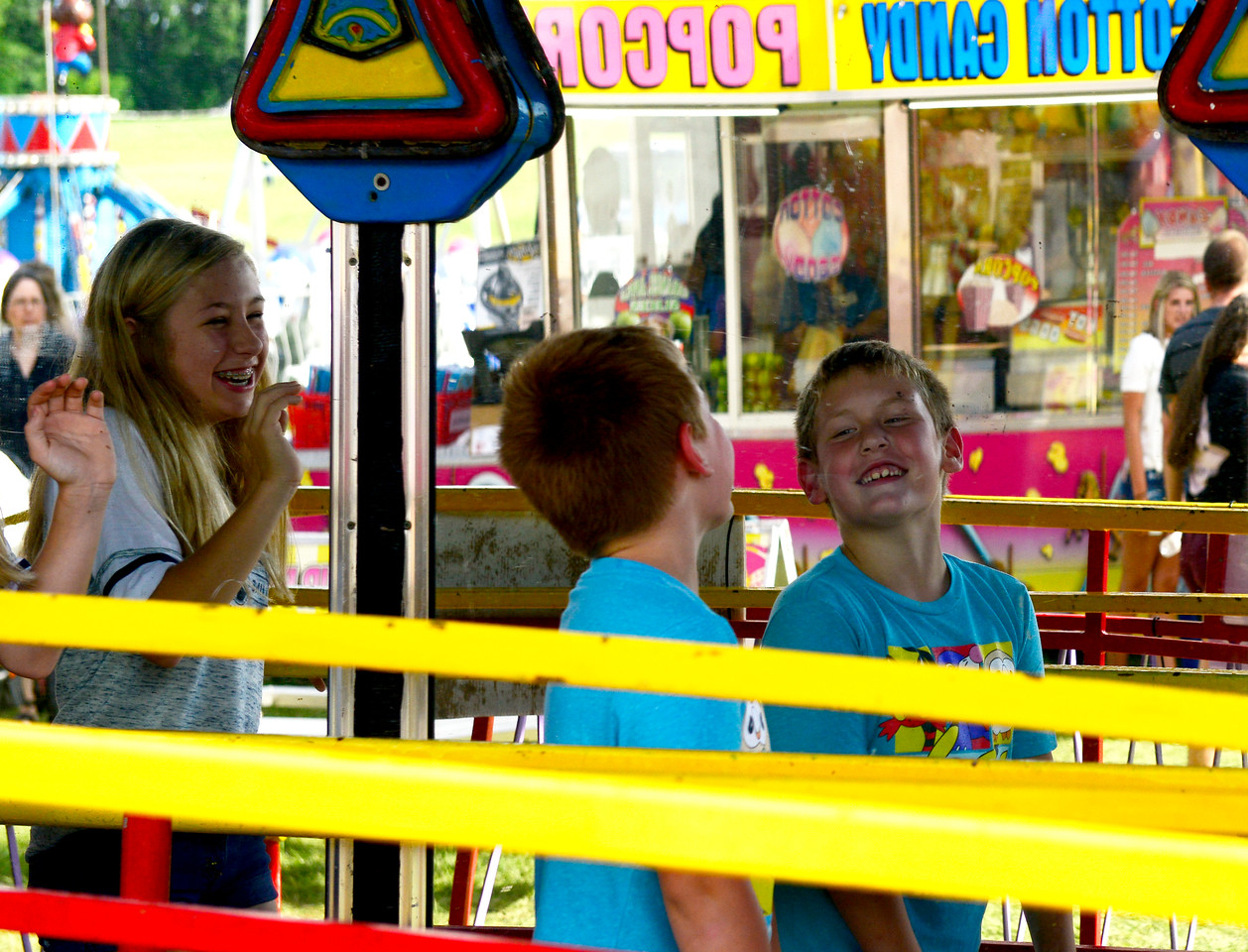 Kayla Wolf - for Shaw Media Payton Damon, 13, laughs as Oliver Fung, 7, looks at himself in the mirror Saturday, July 15, 2017, at Petersen Park. Along with rides and games Fiesta Days offered live music.