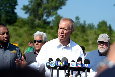 Kayla Wolf - for Shaw Media Illinois Governor Bruce Rauner addresses the media Sunday, July 16, 2017 at Algonquin Public Works. Rauner spoke about the rising water level and then toured parts of Algonquin along the Fox River.