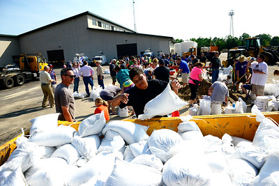 Kayla Wolf - for Shaw Media Volunteers fill sandbags Sunday, July 16, 2017 at Algonquin Public Works. The water is expected to crest on Tuesday.