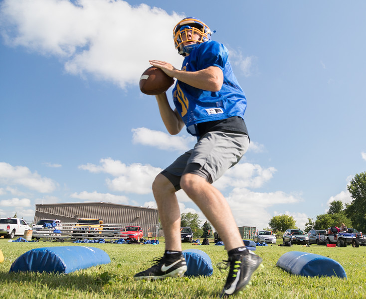 Johnsburg High School senior quarterback Adam Jayco drops back to throw during a practice drill Monday, July 17, 2017 in Johnsburg.  KKoontz-For Shaw Media