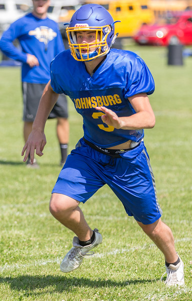 Johnsburg High School senior linebacker Cameron Interrante heads through the offensive line during a practice drill Monday, July 17, 2017 in Johnsburg.  KKoontz-For Shaw Media