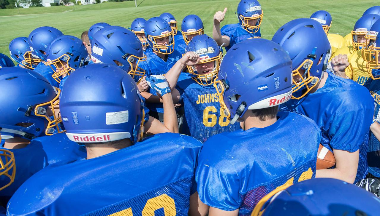 Johnsburg High school football team huddles up during a practice drill Monday, July 17, 2017 in Johnsburg.  KKoontz-For Shaw Media