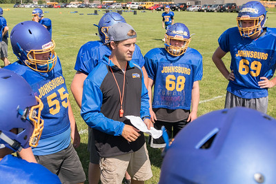 Johnsburg High school football head coach Dan DeBoeuf coaches a play Monday, July 17, 2017 in Johnsburg.  KKoontz-For Shaw Media