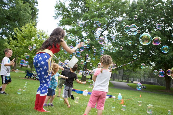 Wonder Woman catches bubbles with kids at the Chris Walk Night Out Against Substance Abuse on July 15 at Mount St. Mary Park in St. Charles. Vicki Foley, Chris Foley's mother, is an employee of the Kane County Chronicle.