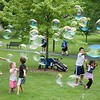 Kids enjoy bubbles as participants walk at the Chris Walk Night Out Against Substance Abuse on July 15 at Mount St. Mary Park in St. Charles. Vicki Foley, Chris Foley's mother, is an employee of the Kane County Chronicle.